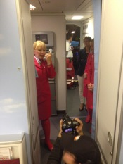 the purser welcoming us on board